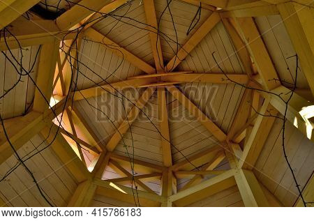 Pergola Ceiling Made Of Wooden Beams By Carpentry By Grafting Wood Into The Shape Of An Octagon. At