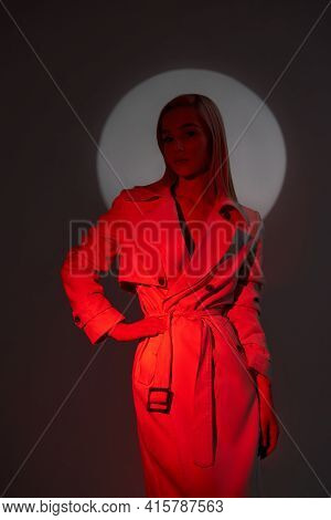 Art Portrait Of A Woman In A Raincoat In A Glowing Circle. Blurry Out Of Focus Face Of A Woman. Cont