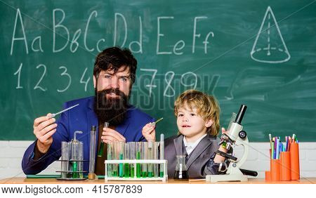 Teacher Child Test Tubes. School Lesson. Chemical Experiment. Difficult Focus And Complete School Ta