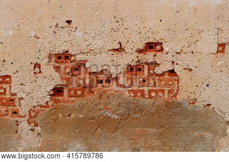 Empty Old Brick Wall Texture. Shabby Facade Of A Brick Building With Damaged Plaster.