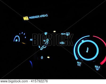 Selective Focus Illuminated Dashboard In Car. Night Mode On Electronic Panel In Car. Neon Blue And R