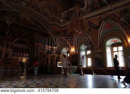 Sergiyev Posad, Russia - June 26, 2019: Interior of Trinity Lavra of St. Sergius monastery. Dark room with natural poor light