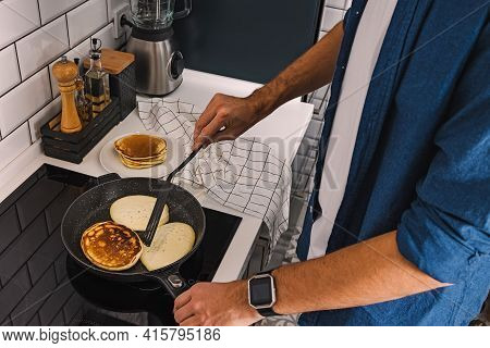 Man Cooking Pancakes For Breakfast Or Brunch