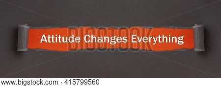 Attitude Changes Everything - Text On Red Background Appears Behind Torn Paper