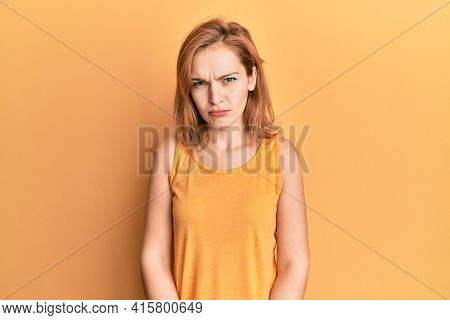 Young caucasian woman wearing casual style with sleeveless shirt skeptic and nervous, frowning upset because of problem. negative person.