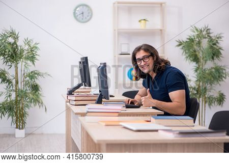 Young male student in tele-education concept