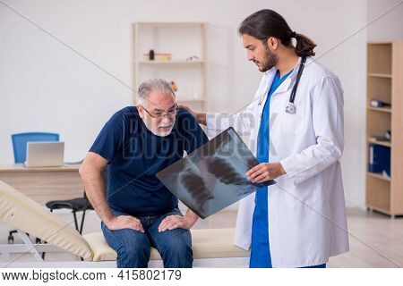 Old male patient visiting young male doctor radiologist