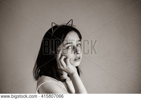 Teenager Girl Black And White Photo. The Girl Looks Into The Camera. Teenager, Young, Girl
