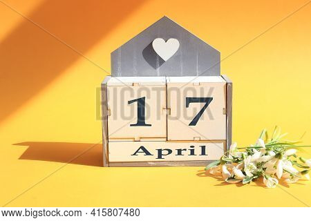 Calendar For April 17: Cubes With The Numbers 0 And 17, The Name Of The Month Of April In English, A