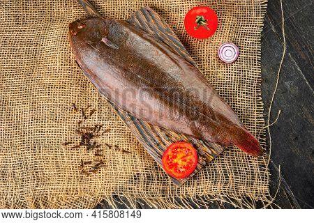 Raw Fresh Sole Fish On A Cutting Board