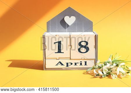 Calendar For April 18: Cubes With The Numbers 0 And 18, The Name Of The Month Of April In English, A
