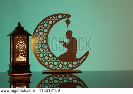Eid Mubarak Concepts With Lamp Inscribed With Arabic Text Translated To English As Ramadhan Is Our L