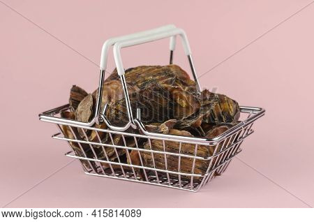 Shopping Basket With Dog Treats On A Pink Background. Natural Treats In A Metal Basket. Dried Bovine