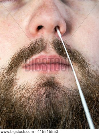 Covid-19 Nasal Swab Test, Taking Nasal Mucus Test Sample, Cotton Swab From The Throat And Nose Close