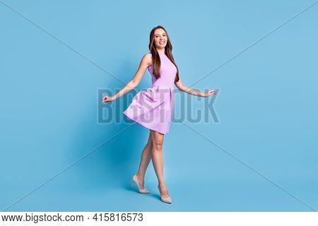 Full Length Profile Photo Of Pretty Girl Walk Shiny Smile Wear Violet Dress Stilettos Isolated Blue