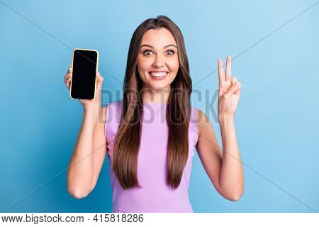 Photo Portrait Of Young Girl Demonstrating Mobile Phone Touchscreen Copyspace Showing V-sign Isolate