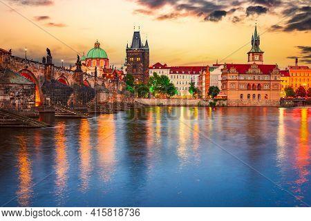 Prague, Czech Republic. Charles Bridge Over Vltava River Sunset And Stare Mesto, Bohemia Famous Plac
