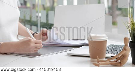 Close Up View Of Female Designer Hands Typing On Computer Laptop While Working At Modern Startup Off