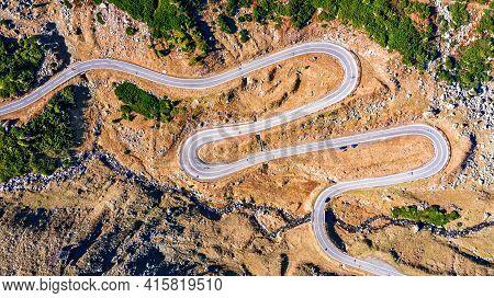 Winding Road Transfagarasan Through Carpathian Mountains At Fall Time. Aerial View By Drone In Roman