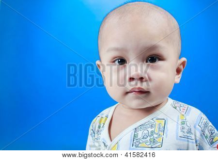 child look in studio and blue background