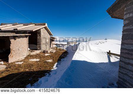 Typical Ancient Stone Cow Shed On Lessinia Plateau (altopiano Della Lessinia) In Winter With Snow Ne
