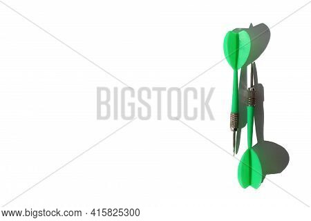 Green Dart Darts Lie On White Background With Place For Text