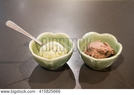 Ice Cream Scoops Or Balls, Chocolate Flavor And Green Tea Flavor In Green Bowl