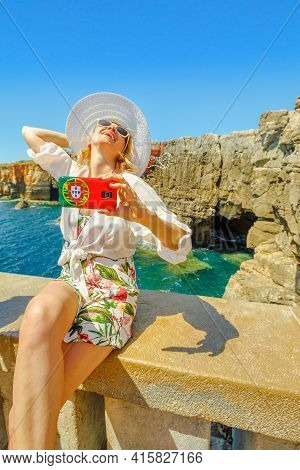 Woman Takes Selfie At Boca Do Inferno In Cascais, Atlantic Ocean, Portugal.female Tourist Takes Pict