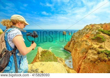 Videomaker On Summer Holidays In Portugal, Europe. Lifestyle Tourist Filming Promontory Of Ponta Da
