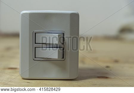 Double Switch Electrical Switch On Wooden Background