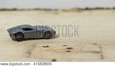 Old Toy Car On Wooden Construction Background