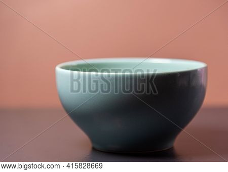 Porcelain Canister On Brown And Dark Background