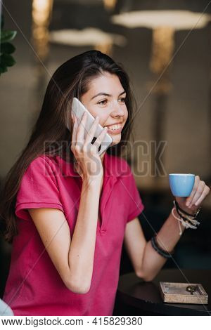 Slender Slim Brunette Girl Talking On The Cell Phone In Cafe. Body Health, Slimness, Self-love
