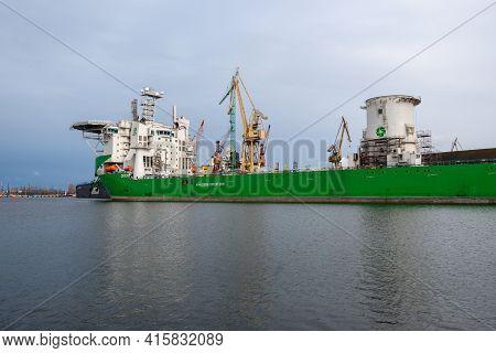 Gdansk, Poland - April 5, 2021: Orion I, A Crane Ship Moored In The Port Of Gdansk During Renovation