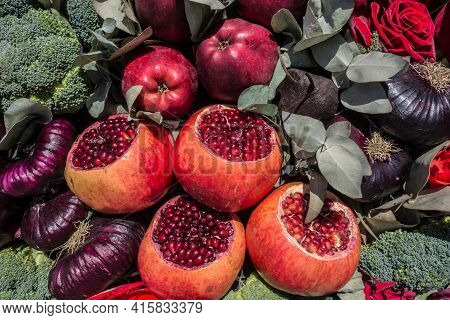 Vegetables, Flowers, Apples And Pomegranates Autumn Background. Beautiful Pattern Of Vegetarian Food