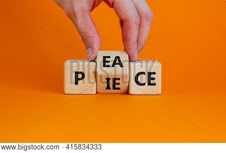 Piece Of Peace Symbol. Businessman Turns Cubes And Changes The Word 'piece' To 'peace'. Beautiful Or