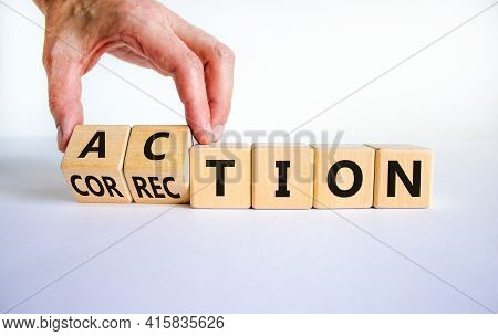 Action Or Correction Symbol. Businessman Turns Wooden Cubes And Changes The Word Correction To Actio