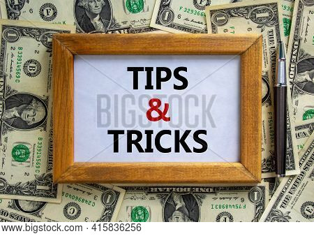 Tips And Tricks Symbol. Wooden Frame With Words 'tips And Tricks' On Beautiful Background From Dolla
