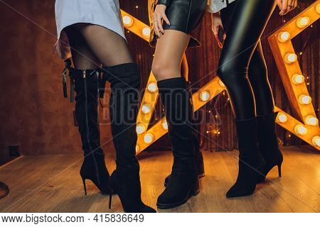 Style. Fashion. Shoes. High Womens Black Boots. Beautiful Female Legs.