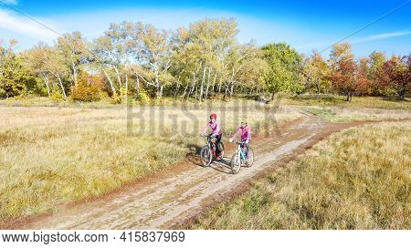 Family On Bikes Autumn Cycling Outdoors, Active Mother And Kid On Bicycles, Aerial View Of Happy Fam