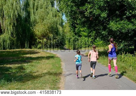 Active Family Fitness Outdoors, Running In Park, Mother And Kids Exercising And Jogging Together, Fa