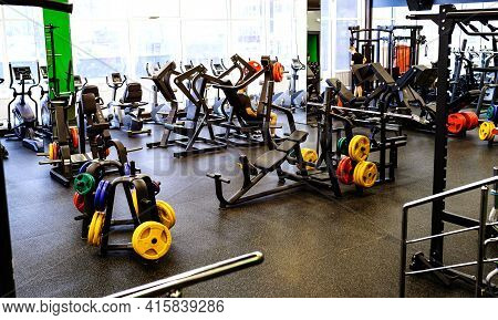 Modern Sports Club. Sports Equipment In The Gym. Barbells Of Different Weights On The Rack. Gym Equi