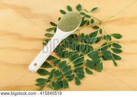 Moringa Powder (moringa Oleifera); Photo On Wooden Background