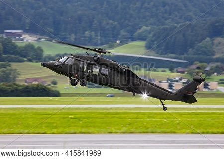 Untitled Military Helicopter Flying. Army Helicopter With No Markings. Air Force. Heli With Mountain