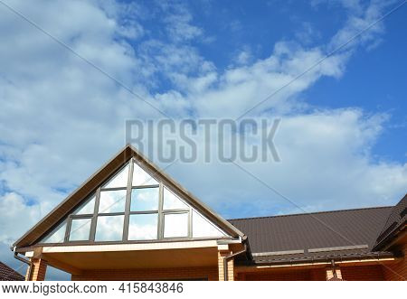 A Modern House With An Attic Panoramic Triangular Window Or Attic Skylight Glass, Window Wall And Me
