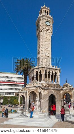 Izmir, Turkey - February 5, 2015: People Are Near The Old Clock Tower On Konak Square. It Was Built