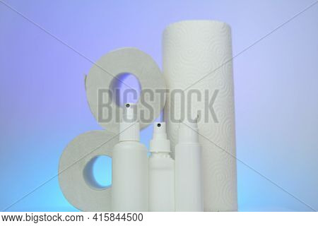 Hygiene And Sanitation . Toilet Paper, Napkins And Antibacterial In Bottles On A Blue Blurred Backgr
