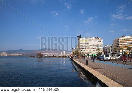Izmir, Turkey - February 5, 2015: Coastal Cityscape Of Izmir City, Ordinary People Walk The Street
