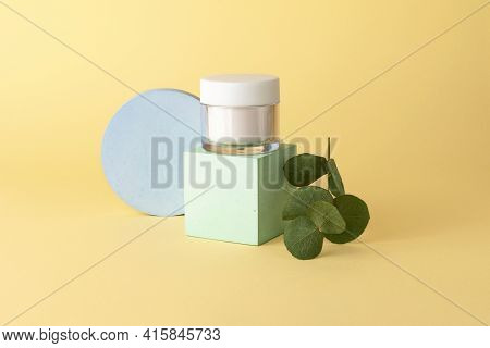 Skin Care Packaging With White Creme,staying On The Geometrical Podium.dried Eucalyptus Near.pastel
