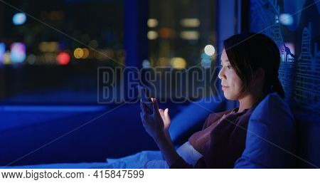 Woman use of smart phone on bed at late night